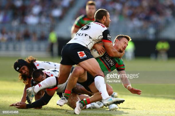 Cody Walker of the Rabbitohs gets tackled during the round one NRL match between the South Sydney Rabbitohs and the New Zealand Warriors at Optus...