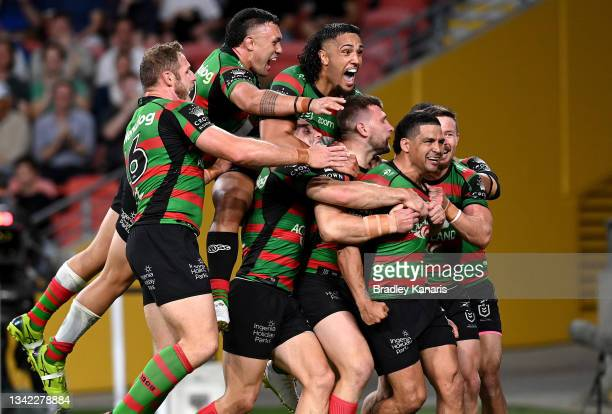 Cody Walker of the Rabbitohs is congratulated by team mates after scoring a try during the NRL Grand Final Qualifier match between the South Sydney...
