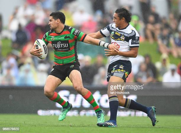 Cody Walker of the Rabbitohs is tackled by Enari Tuala of the Cowboys during the round 16 NRL match between the South Sydney Rabbitohs and the North...