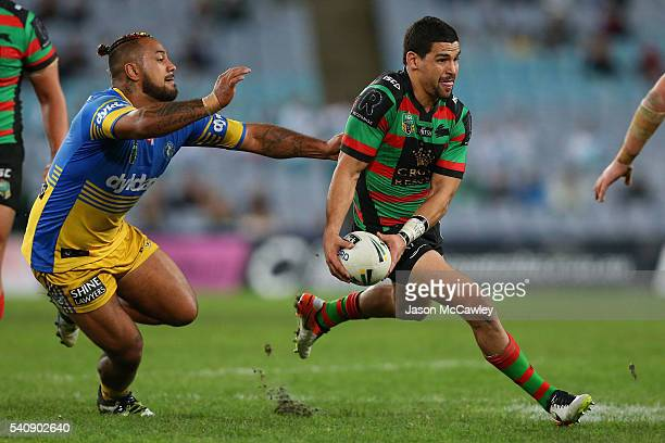 Cody Walker of the Rabbitohs is tackled by Kenny Edwards of the Eels during the round 15 NRL match between the South Sydney Rabbitohs and the...