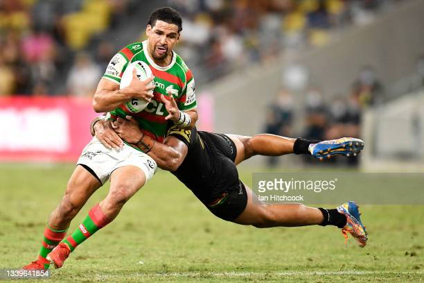 Cody Walker of the Rabbitohs is tackled by Viliame Kikau of the Panthers during the NRL Qualifying Final match between Penrith Panthers and South...