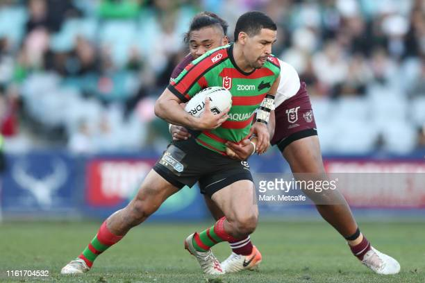 Cody Walker of the Rabbitohs Is tackled during the round 17 NRL match between the South Sydney Rabbitohs and the Manly Sea Eagles at ANZ Stadium on...