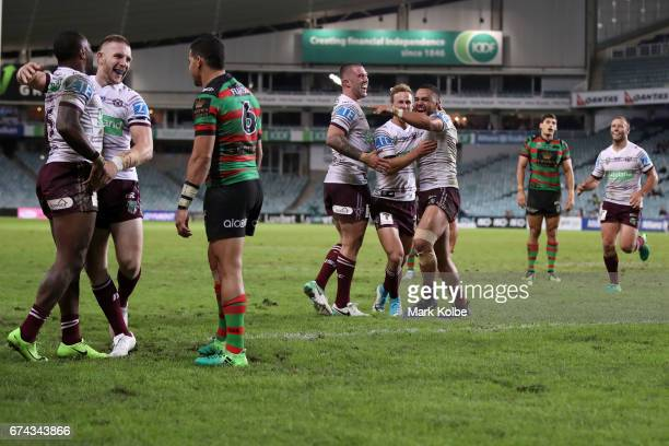 Cody Walker of the Rabbitohs looks dejected as Akuila Uate, Jackson Hastings, Curtis Sironen, Daly Cherry-Evans, Dylan Walker and Blake Green of the...