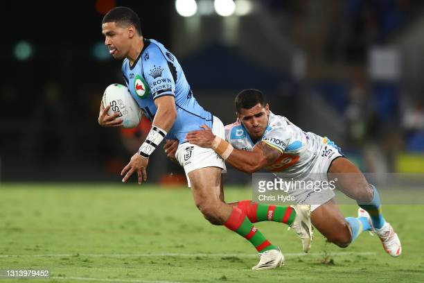 Cody Walker of the Rabbitohs makes a break during the round seven NRL match between the Gold Coast Titans and the South Sydney Rabbitohs at Cbus...