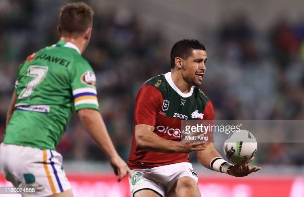 Cody Walker of the Rabbitohs passes during the round 10 NRL match between the Canberra Raiders and the South Sydney Rabbitohs at GIO Stadium on May...