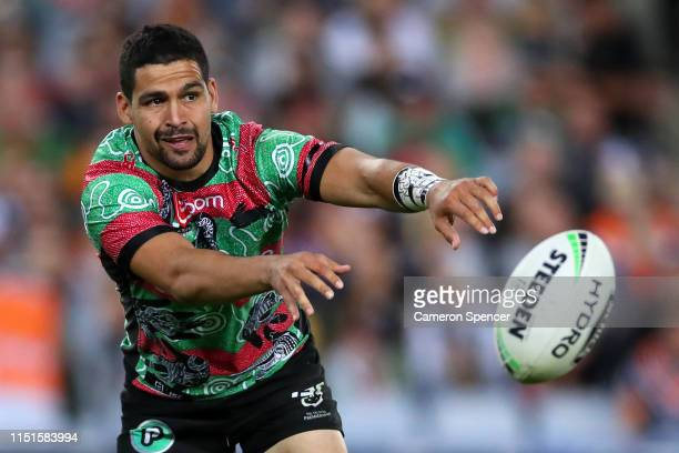 Cody Walker of the Rabbitohs passes during the round 11 NRL match between the South Sydney Rabbitohs and the Wests Tigers at ANZ Stadium on May 25,...