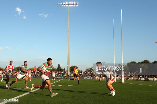 Cody Walker of the Rabbitohs runs at Matt Dufty of the Dragons during the Charity Shield & NRL Trial Match between the South Sydney Rabbitohs and the...