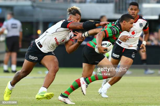 Cody Walker of the Rabbitohs runs the ball during the round one NRL match between the South Sydney Rabbitohs and the New Zealand Warriors at Optus...
