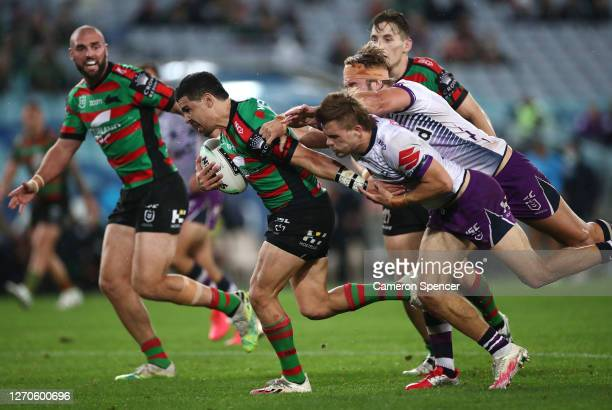 Cody Walker of the Rabbitohs runs with the ball during the round 17 NRL match between the South Sydney Rabbitohs and the Melbourne Storm at ANZ...