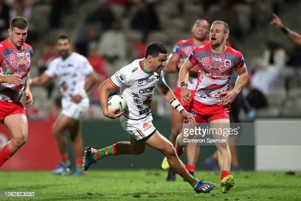 Cody Walker of the Rabbitohs scores a try during the round 12 NRL match between the St George Illawarra Dragons and the South Sydney Rabbitohs at...