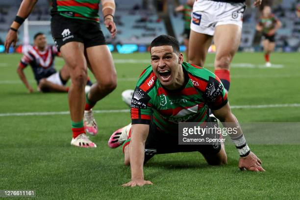 Cody Walker of the Rabbitohs scores a try during the round 20 NRL match between the South Sydney Rabbitohs and the Sydney Roosters at ANZ Stadium on...