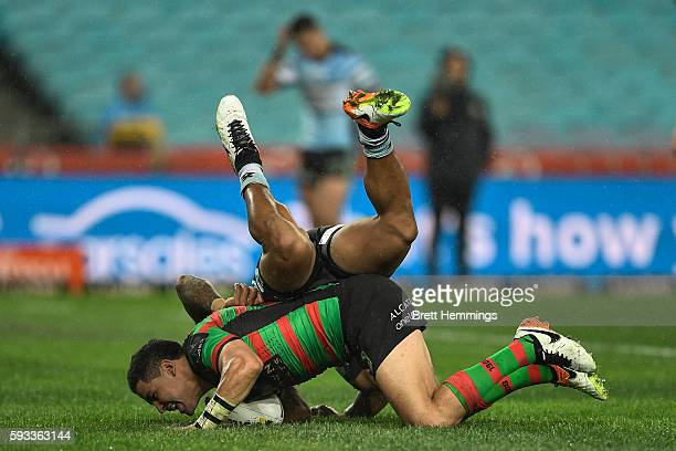 Cody Walker of the Rabbitohs scores a try during the round 24 NRL match between the South Sydney Rabbitohs and the Cronulla Sharks at ANZ Stadium on...