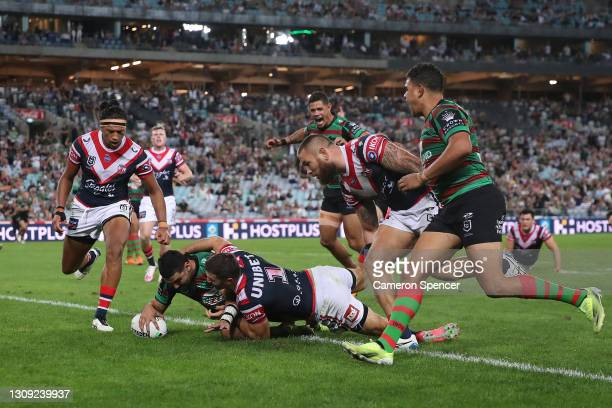 Cody Walker of the Rabbitohs scores a try during the round three NRL match between the South Sydney Rabbitohs and the Sydney Roosters at Stadium...