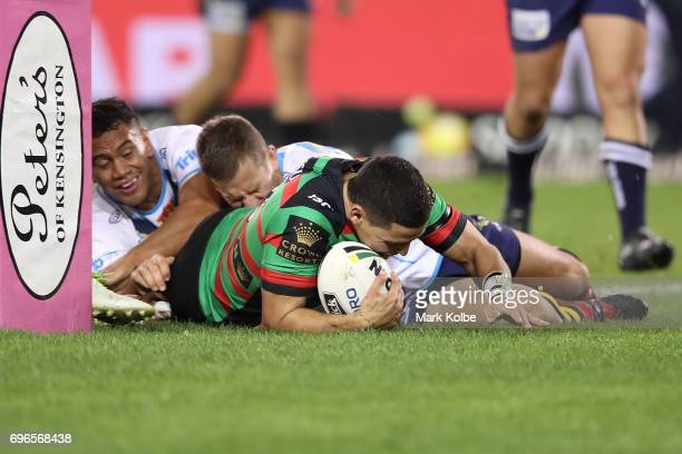 Cody Walker of the Rabbitohs scores try during the round 15 NRL match between the South Sydney Rabbitohs and the Gold Coast Titans at ANZ Stadium on...