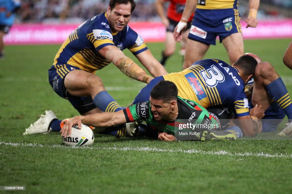 Cody Walker of the Rabbitohs stretches out in an attempt to score a try only to have the try disallowed on review during the round 20 NRL match between the South Sydney Rabbitohs and the Parramatta Eels at ANZ Stadium on July 28, 2018 in Sydney, Australia.