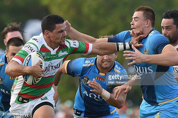 Cody Walker of the Rabbitohs takes on the defence during the NRL trial match between the Gold Coast Titans and the South Sydney Rabbitohs at Pizzey...