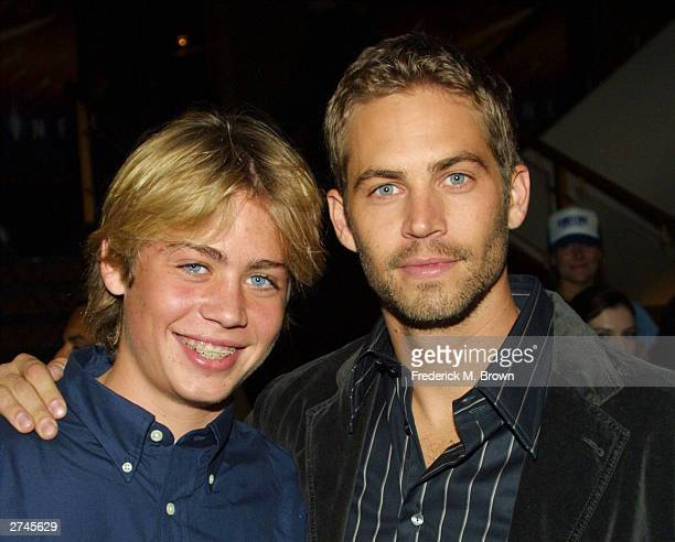Cody Walker with his brother actor Paul Walker pose during the film premiere of 'Timeline' at the Mann's National Theatre on November 19 2003 in...