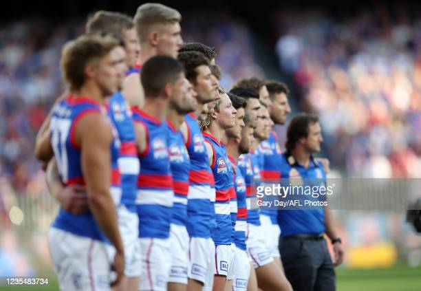 Cody Weightman of the Bulldogs is seen lining up with the team for the national anthem before the 2021 Toyota AFL Grand Final match between the...