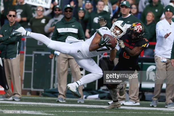 Cody White of the Michigan State Spartans catches a pass against RaVon Davis of the Maryland Terrapins during the first half at Capital One Field on...