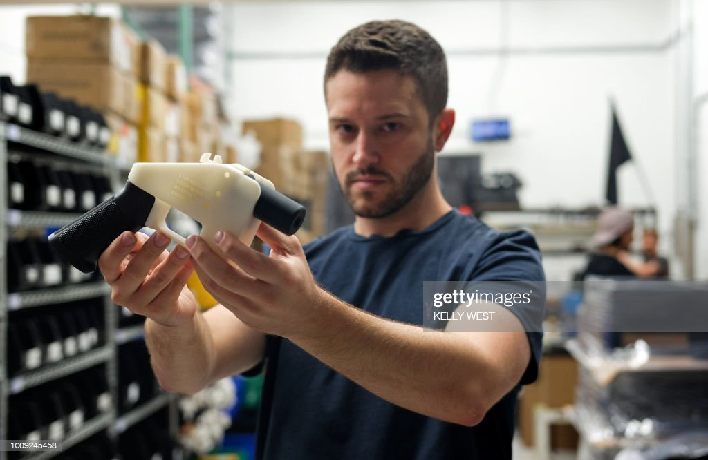 TOPSHOT - Cody Wilson, owner of Defense Distributed company, holds a 3D printed gun, called the 'Liberator', in his factory in Austin, Texas on August 1, 2018. - The US 'crypto-anarchist' who caused panic this week by publishing online blueprints for 3D-printed firearms said Wednesday that whatever the outcome of a legal battle, he has already succeeded in his political goal of spreading the designs far and wide. A federal court judge blocked Texan Cody Wilson's website on Tuesday, July 31, 2018, by issuing a temporary injunction.