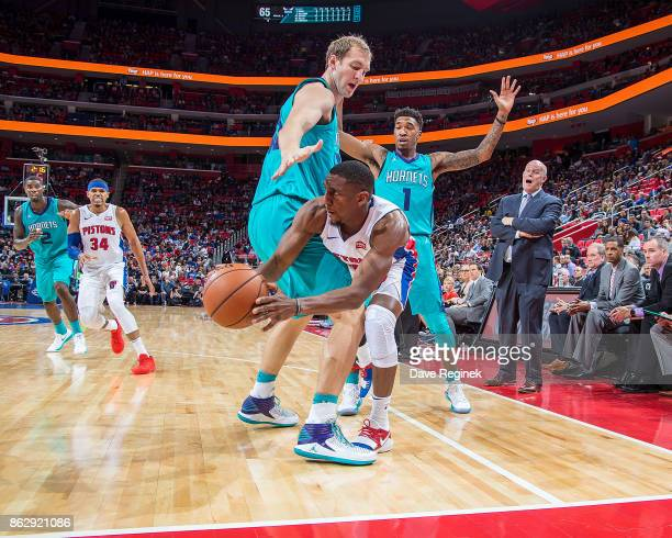 Cody Zeller and Malik Monk of the Charlotte Hornets try to trap Langston Galloway of the Detroit Pistons during the Inaugural NBA game at the new...