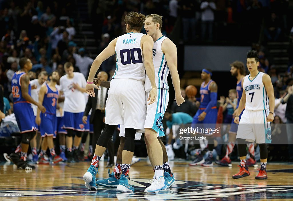 Cody Zeller #40 celebrates with teammate Spencer Hawes #00 of the Charlotte Hornets after hitting the game winning shot to defeat the New York Knicks 95-93 during their game at Time Warner Cable Arena on November 11, 2015 in Charlotte, North Carolina.