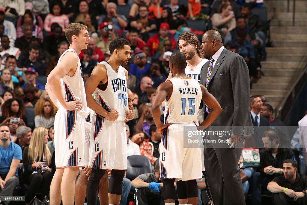 Cody Zeller #40, Jeffery Taylor #44, Kemba Walker #15, and Josh McRoberts #11 of the Charlotte Bobcats confer with acting Head Coach Patrick Ewing during the game against the New York Knicks at the Time Warner Cable Arena on November 8, 2013 in Charlotte, North Carolina.