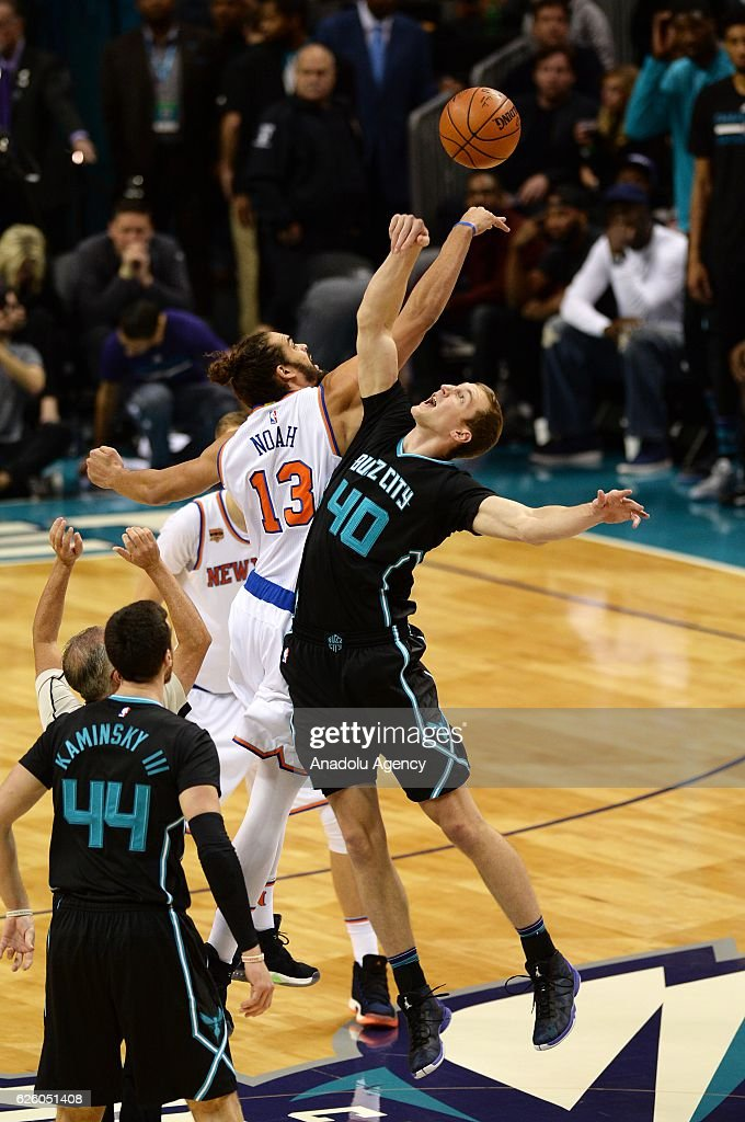 Cody Zeller (R) of Charlotte Hornets jumps with Joakim Noah (L) of New York Knicks in the beginning of the NBA match between New York Knicks vs Charlotte Hornets at the Spectrum arena in Charlotte, NC, USA on November 26, 2016.