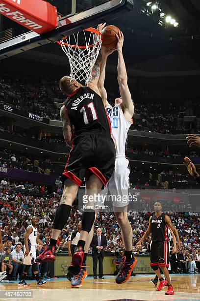 Cody Zeller of the Charlotte Bobcats has his shot blocked by Chris Andersen of the Miami Heat in Game Four of the Eastern Conference Quarterfinals...