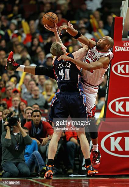 Cody Zeller of the Charlotte Bobcats tries to shoot against Taj Gibson of the Chicago Bulls at the United Center on November 18 2013 in Chicago...