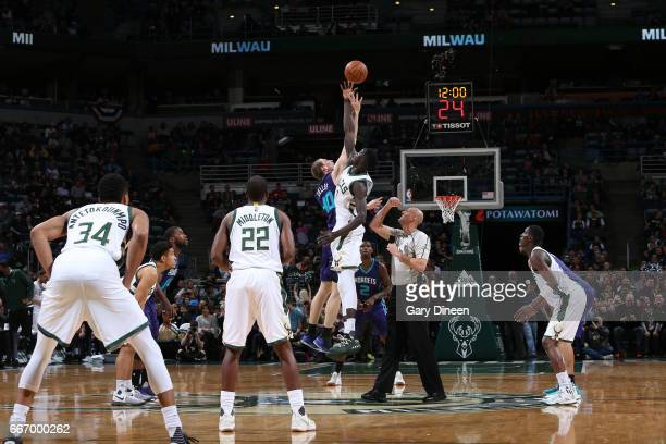 Cody Zeller of the Charlotte Hornets and Thon Maker of the Milwaukee Bucks jump for possession of the ball on April 10 2017 at the BMO Harris Bradley...