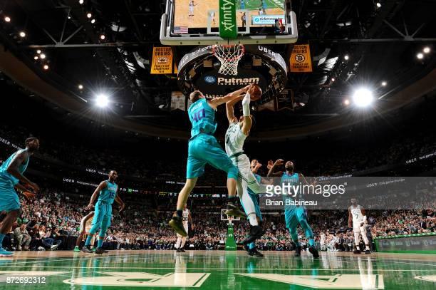 Cody Zeller of the Charlotte Hornets blocks the shot of Jayson Tatum of the Boston Celtics on November 10 2017 at the TD Garden in Boston...