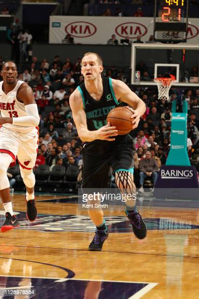 Cody Zeller of the Charlotte Hornets dribbles the ball during the game against the Miami Heat on March 6 2019 at Spectrum Center in Charlotte North...