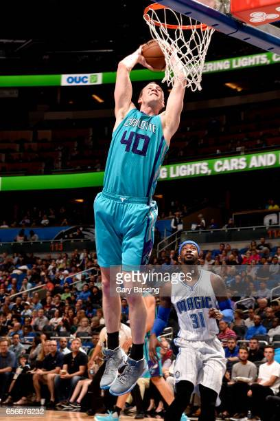 Cody Zeller of the Charlotte Hornets dunks against the Orlando Magic on March 22 2017 at the Amway Center in Orlando Florida NOTE TO USER User...