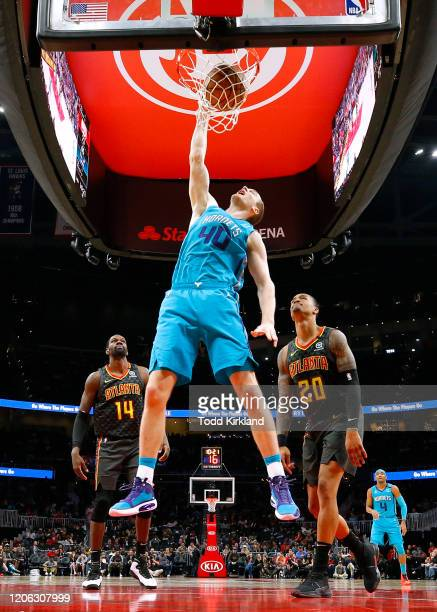 Cody Zeller of the Charlotte Hornets dunks during the second half of an NBA game against the Atlanta Hawks at State Farm Arena on March 9, 2020 in...
