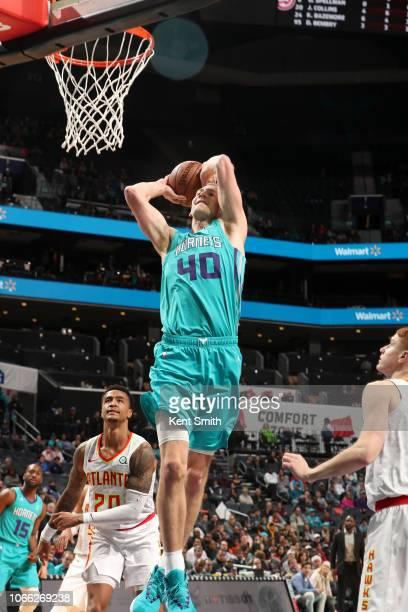 Cody Zeller of the Charlotte Hornets dunks the ball against the Atlanta Hawks on November 28 2018 at the Spectrum Center in Charlotte North Carolina...