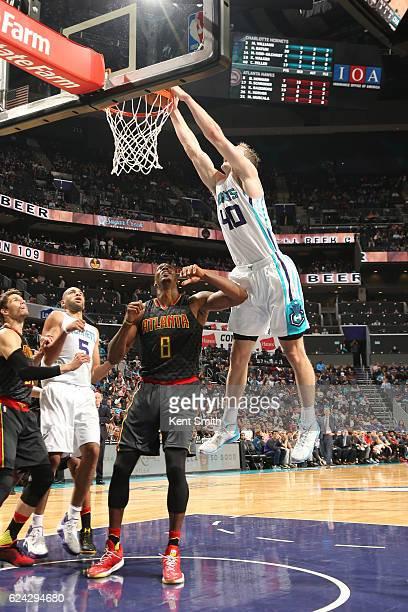 Cody Zeller of the Charlotte Hornets dunks the ball during a game against the Atlanta Hawks on November 18 2016 at the Spectrum Center in Charlotte...