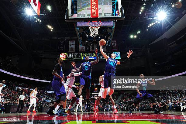 Cody Zeller of the Charlotte Hornets gets the rebound during the game against the Atlanta Hawks on December 17 2016 at Philips Arena in Atlanta...