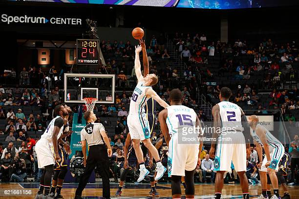 Cody Zeller of the Charlotte Hornets goes for the tip off against the Indiana Pacers during the game on November 7 2016 at Spectrum Center in...