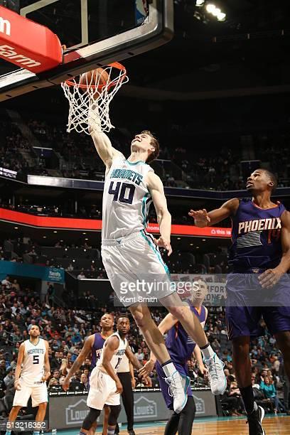 Cody Zeller of the Charlotte Hornets goes to the basket against the Phoenix Suns on March 1 2016 at Time Warner Cable Arena in Charlotte North...