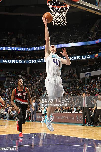 Cody Zeller of the Charlotte Hornets goes to the basket against the Portland Trail Blazers on January 18 2017 at Spectrum Center in Charlotte North...