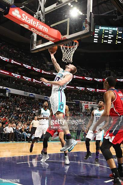 Cody Zeller of the Charlotte Hornets goes to the basket against the Washington Wizards on January 23 2017 at Spectrum Center in Charlotte North...