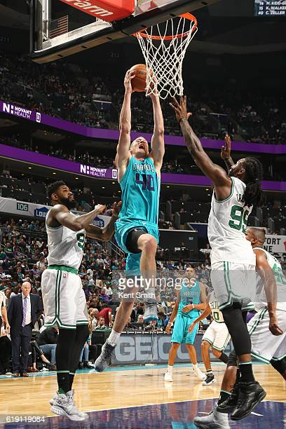 Cody Zeller of the Charlotte Hornets goes up for a dunk during a game against the Boston Celtics on October 29 2016 at the Spectrum Center in...