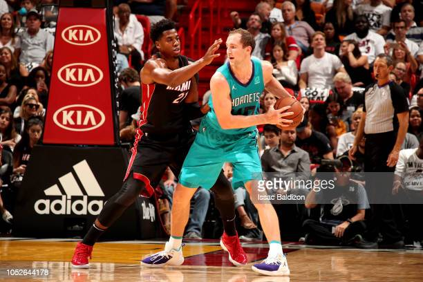 Cody Zeller of the Charlotte Hornets handles the ball against the Miami Heat on October 20 2018 at American Airlines Arena in Miami Florida NOTE TO...