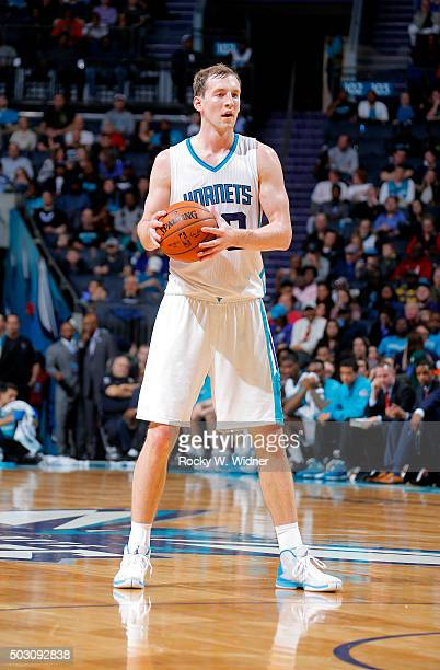 Cody Zeller of the Charlotte Hornets handles the ball against the Boston Celtics on December 23 2015 at Time Warner Cable Arena in Charlotte North...