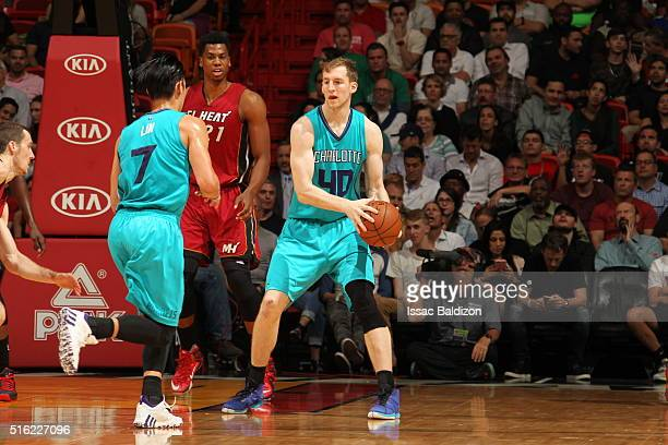 Cody Zeller of the Charlotte Hornets handles the ball against the Miami Heat on March 17 2016 at AmericanAirlines Arena in Miami Florida NOTE TO USER...