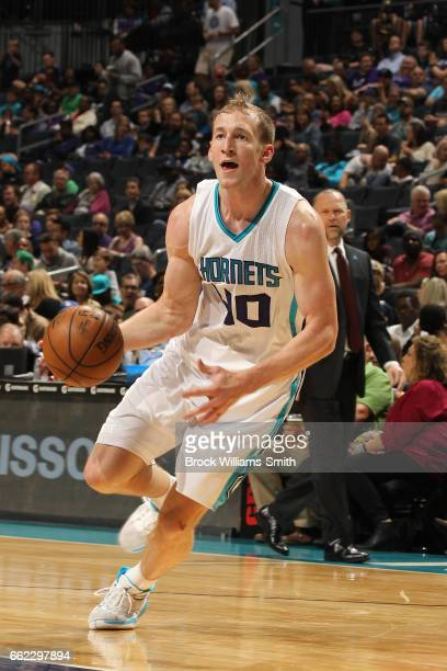 Cody Zeller of the Charlotte Hornets handles the ball against the Denver Nuggets on March 31 2017 at Spectrum Center in Charlotte North Carolina NOTE...