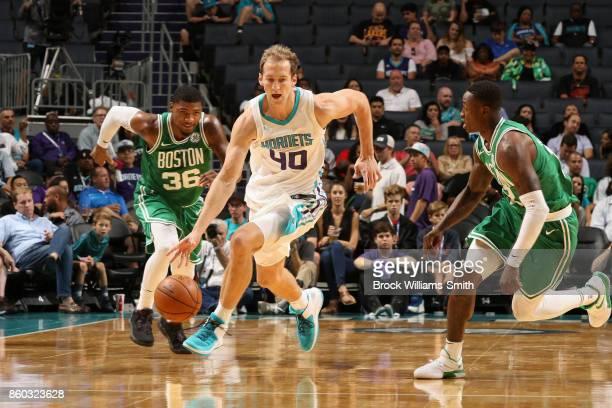 Cody Zeller of the Charlotte Hornets handles the ball against the Boston Celtics on October 11 2017 at Spectrum Center in Charlotte North Carolina...