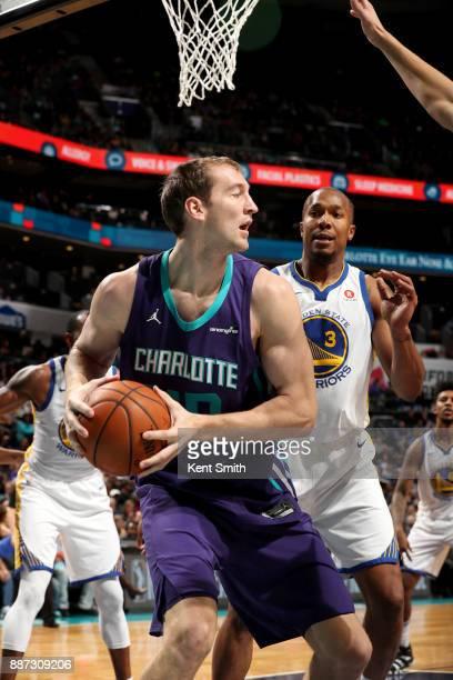 Cody Zeller of the Charlotte Hornets handles the ball against the Golden State Warriors on December 6 2017 at Spectrum Center in Charlotte North...