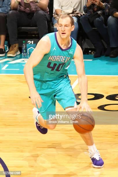 Cody Zeller of the Charlotte Hornets handles the ball during the game against the Detroit Pistons on December 21 2018 at Spectrum Center in Charlotte...